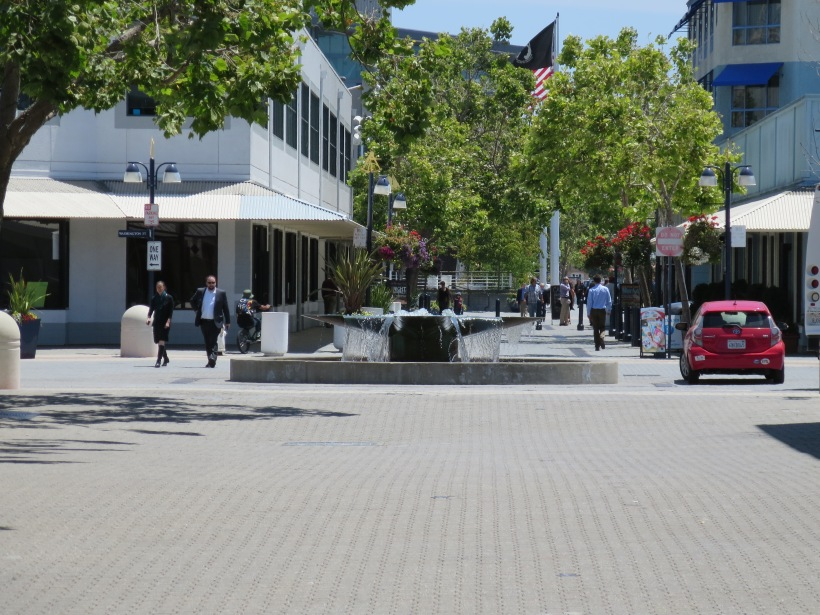 Water Street in Oakland's Jack London Square is a great shared street. Here pedestrians, cyclists and cars coexist without segregation of uses. The only way this works is because pedestrians and cyclists are given the highest priority in this street.