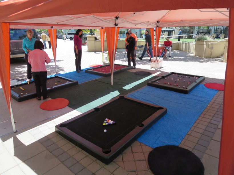Billiards modified for a public event were among the activities at the Adult Recess