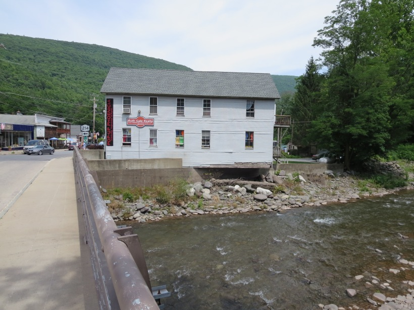 The Stony Clove Creek, in Phoenicia, flooded during Hurricane Irene and it appears that this building lost some of its foundation at that time. Though the creek presents hazards, it also has a potential. A great restaurant deck could be provided near the creek so that visiting tourists could enjoy the sounds and view of the river while eating.