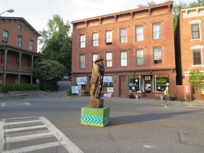 A statue of Rip Van Winkle watches over the north end of downtown Catskill's Main St.