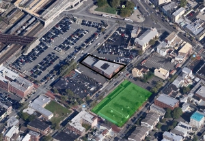 The building outlined in black has been demolished and is the subject of the Zoning Board application for use as a surface parking lot. The area in green has already been converted into a surface parking lot and the Zoning Board decision is being appealed.