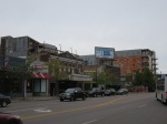 Stores and restaurants on Lyndale Ave with a new mixed use development in the background.