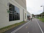 Cyclists leave the Freewheel Midtown Bike Center along the Midtown Greenway.
